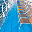 Stock Photo: Sunbath chairs on side of cruise liner
