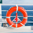 Red life buoy on side of cruise liner — Stok Fotoğraf #7218313