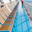 Sunbath chairs on side of cruise liner — Stock Photo