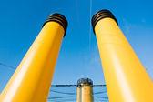 Three yellow funnels — Stock Photo