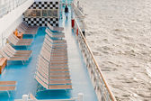 Sunbath chairs on side of cruise liner at morning — Стоковое фото