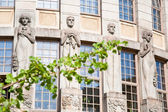 Sculpture of Kalevala heroes on wall of old house, Helsinki — Stock Photo