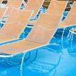 Textile chairs on wet deck of cruise liner - Stock Photo