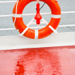 Life buoy on sea cruise liner - Stock Photo