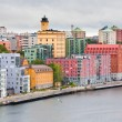 Many-colored buildings on waterfront in Stockholm - Stock Photo