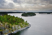 Small stone islands in swedish fiord at sunset — Stock Photo