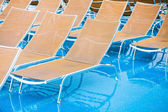 Textile chairs on wet deck of cruise liner — Stock Photo