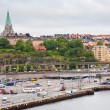 View on shipping terminal and old Sofia Church in Stockholm — Stock Photo