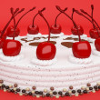 I love you: cake with cherries over red — Stock Photo
