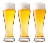Beer into glass isolated on white. three options — Stock Photo