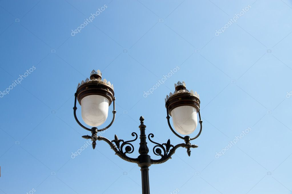 Ancient lamppost against a blue sky — Stock Photo #6888884