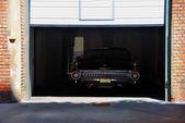 Vintage car in garage — Stock Photo