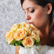BRIDE LOOKING AT BOUQUET — Stock Photo #7311260