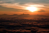 Sunrise above clouds — Stock Photo