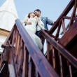 Newlyweds on the stairs — Stock Photo
