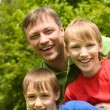 Dad with sons at nature - Stock Photo