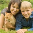 Boy with mom and cat - Stock Photo