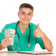 Stock Photo: Young doctor with money