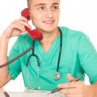 Stock Photo: Nice doctor with telephone