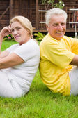 Pretty aged couple outdoors — Stock Photo