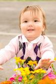 Baby with flowers — Zdjęcie stockowe