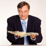 Smart businessman with money — Stock Photo