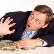 Businessman with money — Stock Photo #6821334