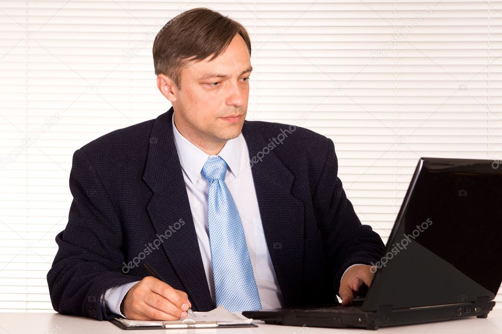 Portrait of a businessman with computer — Stock Photo #6821544