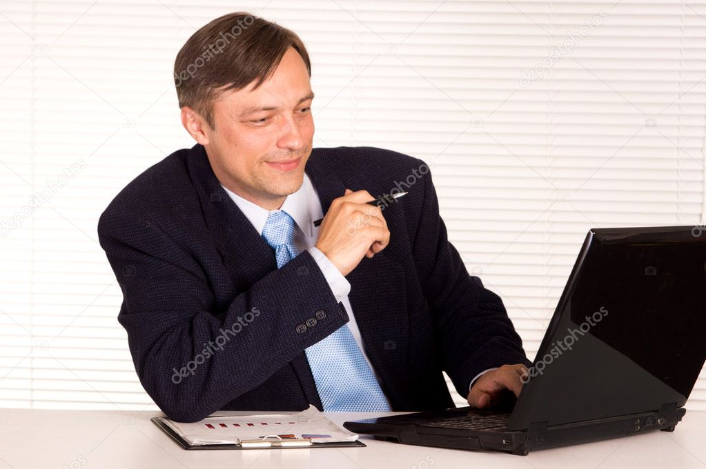 Portrait of a businessman with computer — Stock Photo #6821559
