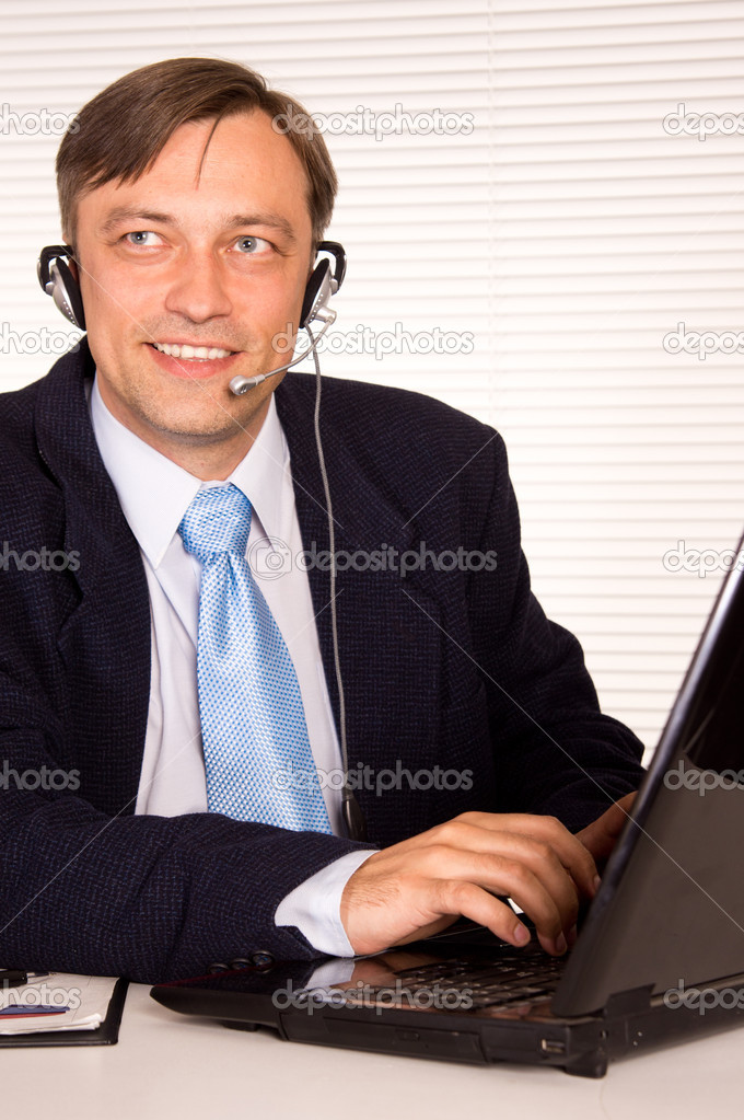 Portrait of a nice man with computer  Stock Photo #6821726