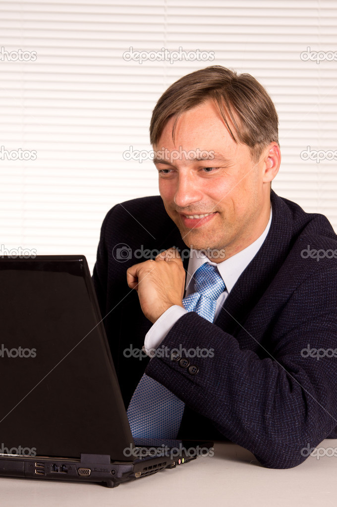 Portrait of a nice man with computer  Stock Photo #6822291