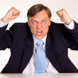 Angry businessman portrait — Stock Photo