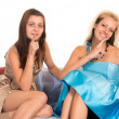 Girls at sofa — Stock Photo