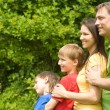 Smart family outdoors — Stock Photo #6938565