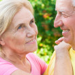 Aged couple ouside - Stock Photo