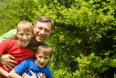 Dad with sons at nature — Stock Photo