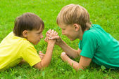 Two boys on grass — Stock Photo