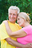 Old couple at nature — Stock Photo