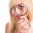 Girl with loupe — Stock Photo #6940189
