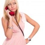 Girl and telephone — Stock Photo #6940235