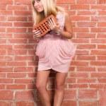 Girl at wall — Stock Photo #6940325