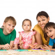 Family at carpet — Stock Photo #6943099
