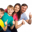 Family of a four on white — Stock Photo #6943100