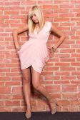 Blonde at wall — Stock Photo