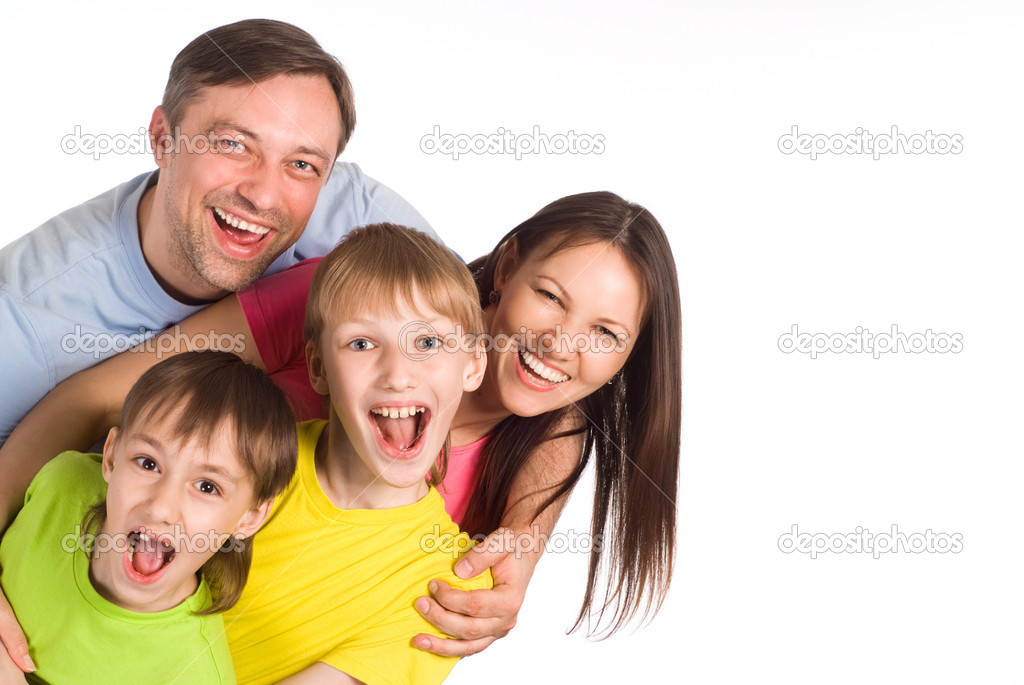 Family of a four on a  white — Stock Photo #6943104