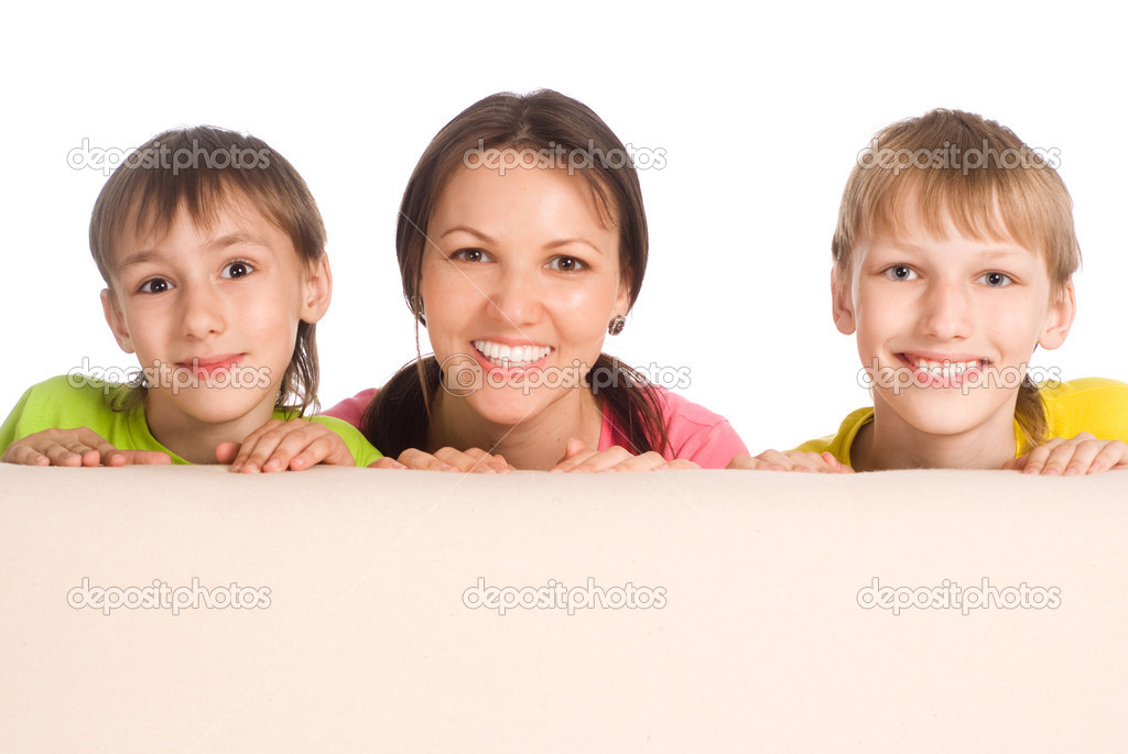 Cute mom with her little boys on sofa — Stock Photo #6943107