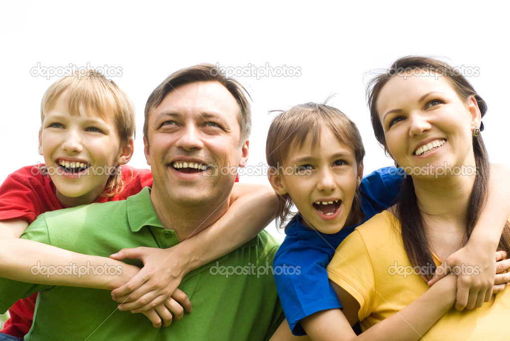 Cute family of a four at nature  Stock Photo #6943124