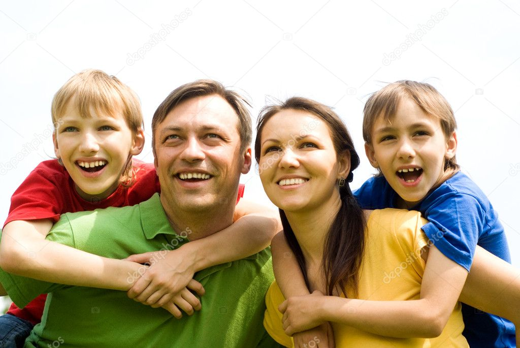 Cute family of a four at nature — Stock Photo #6943132