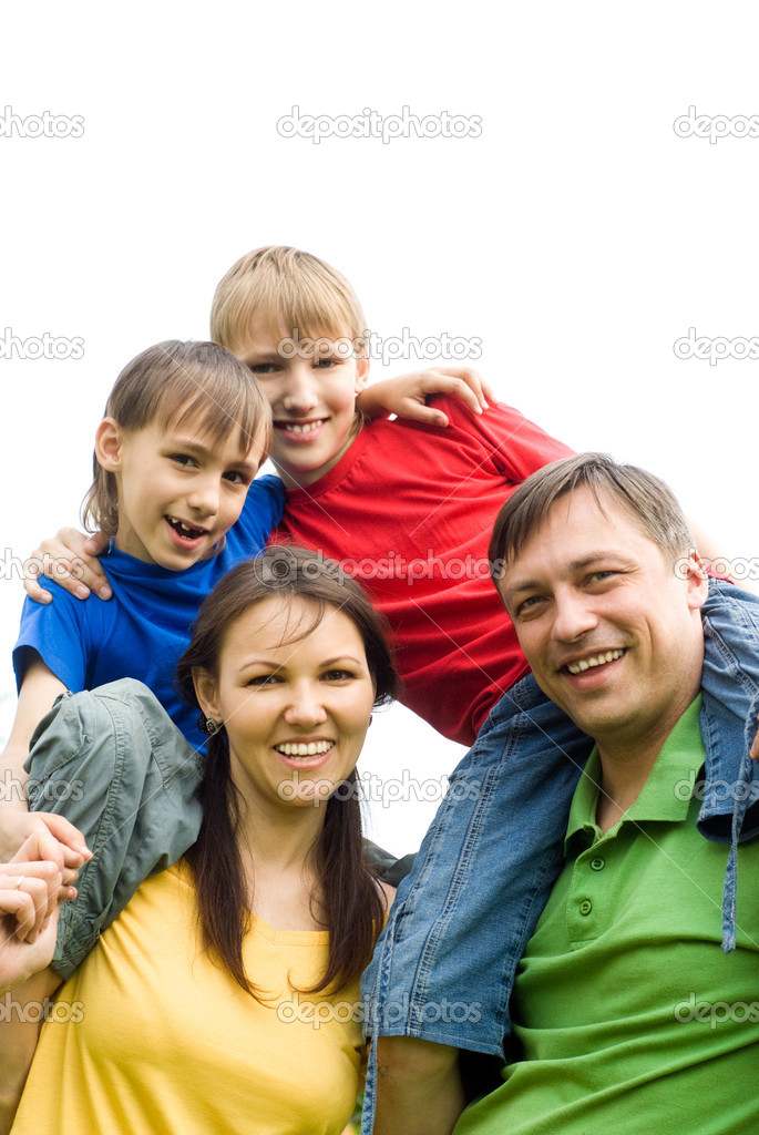 Cute family of a four at nature — Stock Photo #6943139