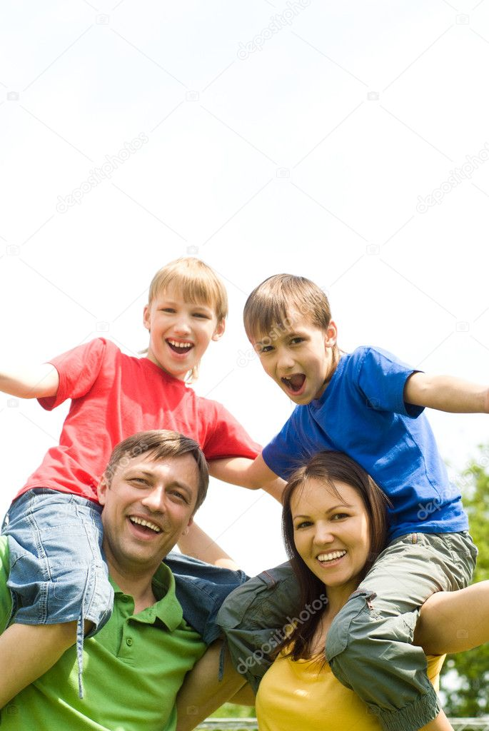 Cute family of a four at nature  Stock Photo #6943149